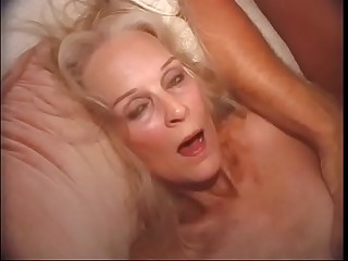 Barbie takes on two guy'_s in her grey holes.
