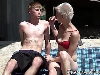 Gnome grandma guzzles young cock lower than bridge
