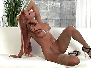 Hot redhead lingerie tease at hand short stockings
